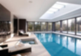 Indoor Swimming Pool With Panoramic Windows and Sunlight with loungers