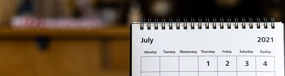 July 2021 calendar - month page showing date on wooden table_edited.jpg