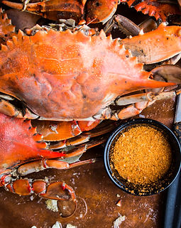 Maryland blue crabs with seafood utensil
