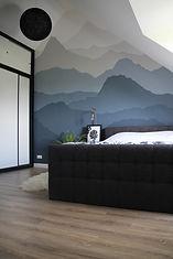 Muurschildering op slaapkamer
