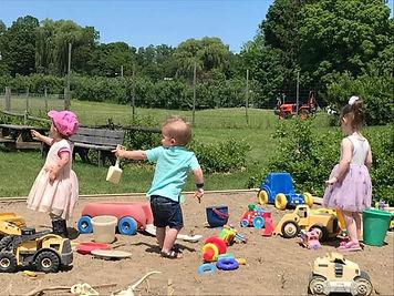 kids in sandbox hurds family farm playgr