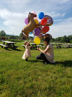 horse balloons with toddler hudson valle