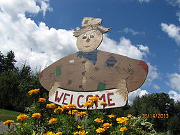 Welcome to Hurds Famil Farm scarecrow sign