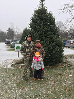 military family with christmas tree for