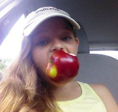 Jurni Hurd eats an NY apple.jpg