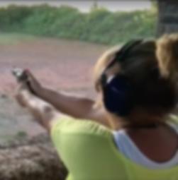 female shooting gun
