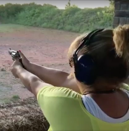 female shooting gun