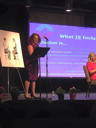 Lisa Drennan speaking to an audience on the topic of community inclusion