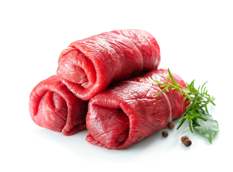 Raw beef roulades isolated on white background.jpg