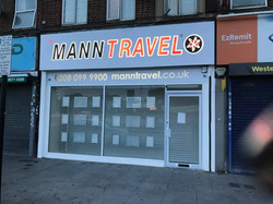 Mann Travel Shop Signage