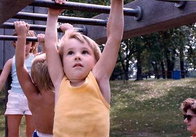 Child on monkey bars