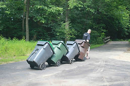 Trash cans to the street