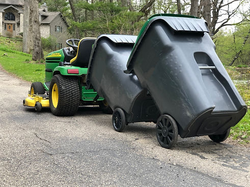 Garbage hauling device for lawnmower
