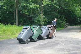 walking garbage cans down to the street