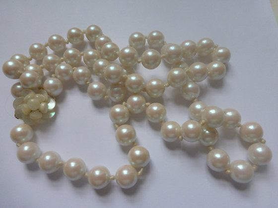 A lovely knotted double strand of faux pearls