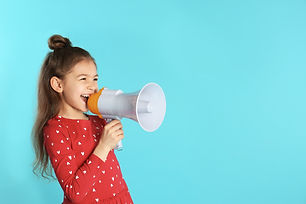 Cute funny girl with megaphone on color
