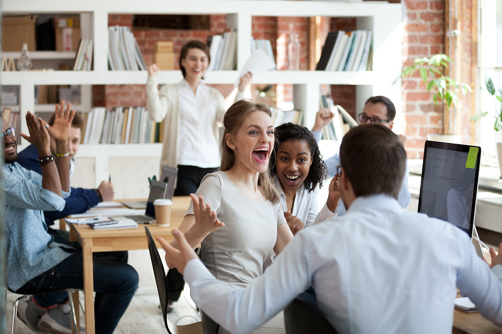 Excited diverse business team employees