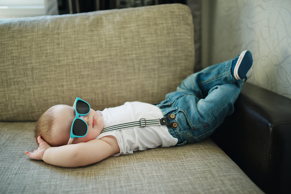 cute little boy in sunglasses at home.jp