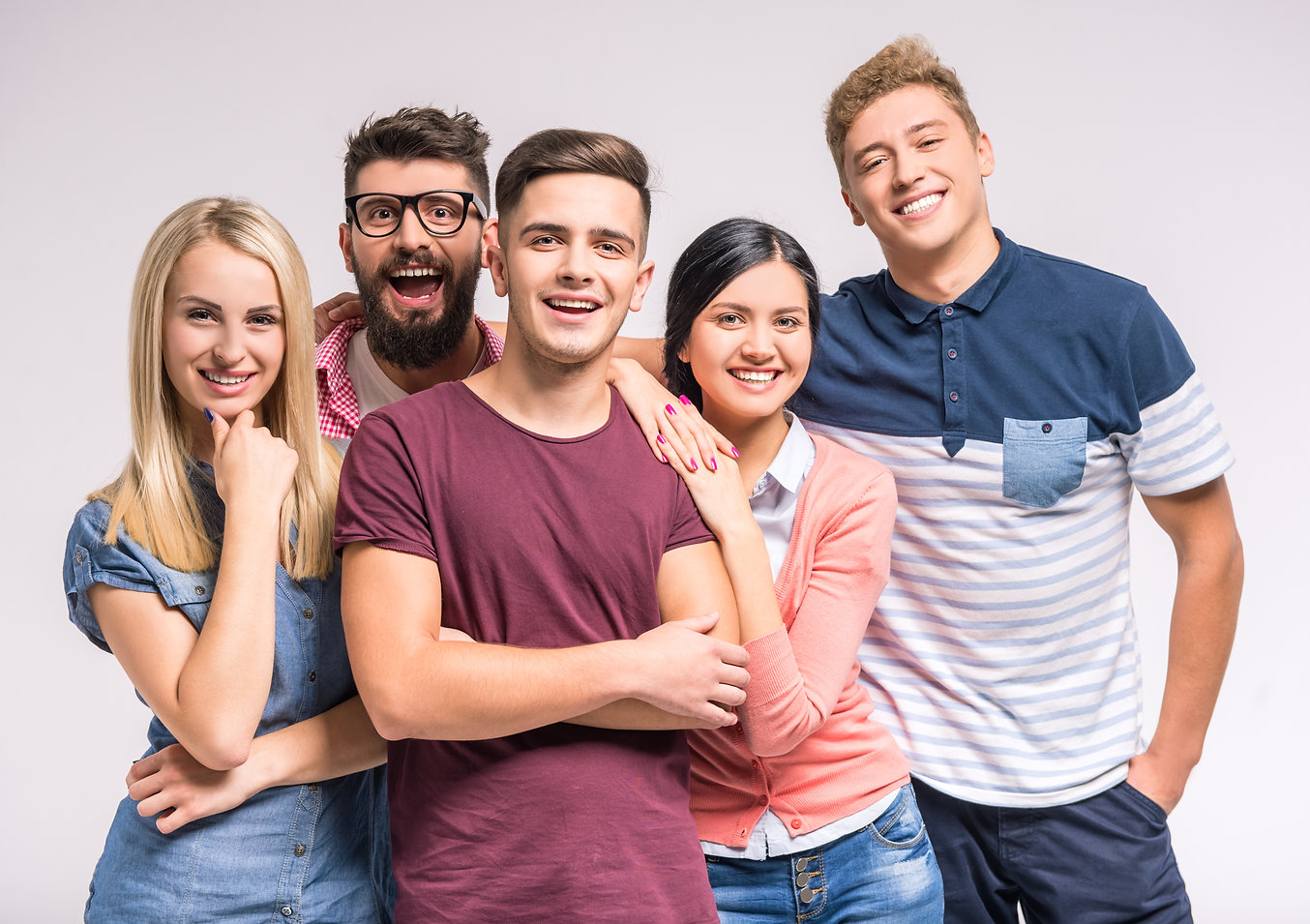 Funny young people on a gray background.