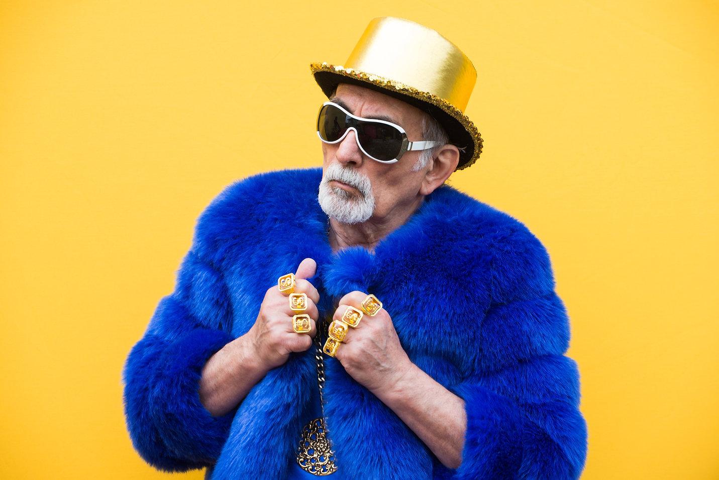 Funny and extravagant senior man posing