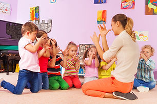 Kids repeat gesture in classroom after t
