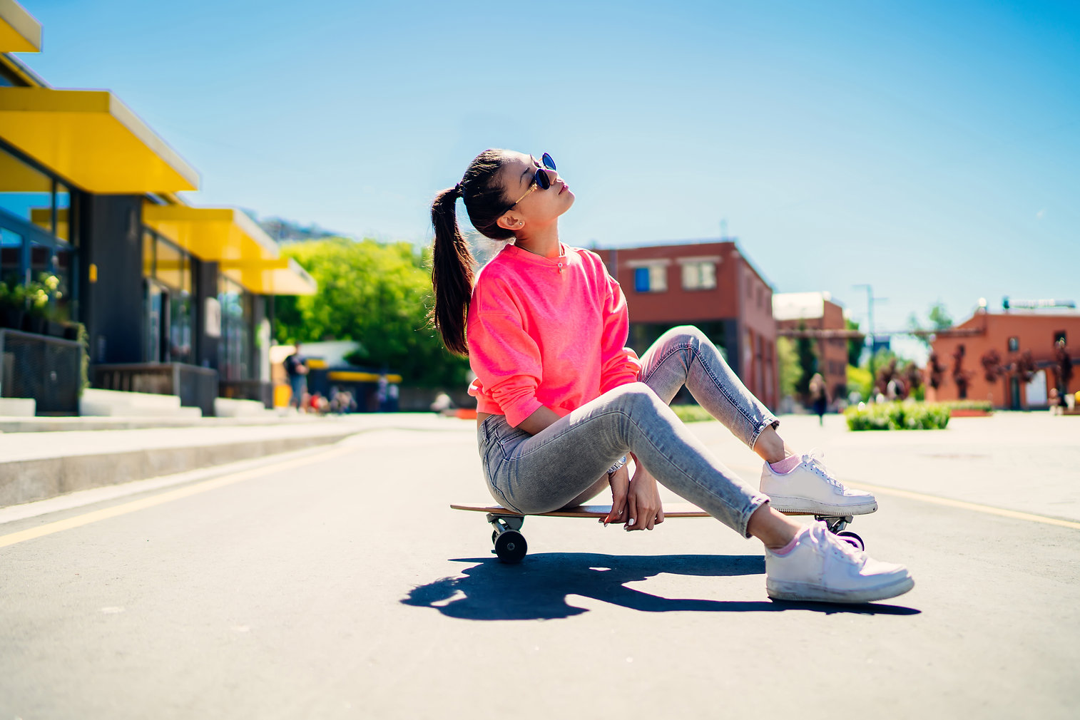 Attractive female teenager in stylish su