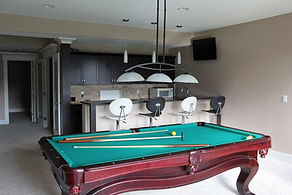 Basement home renovations with pool table