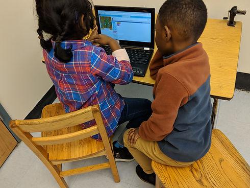 Two children coding