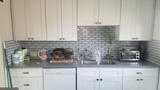 New Kitchen Cabinets and Backsplash. Countertops done by a Graint Company.