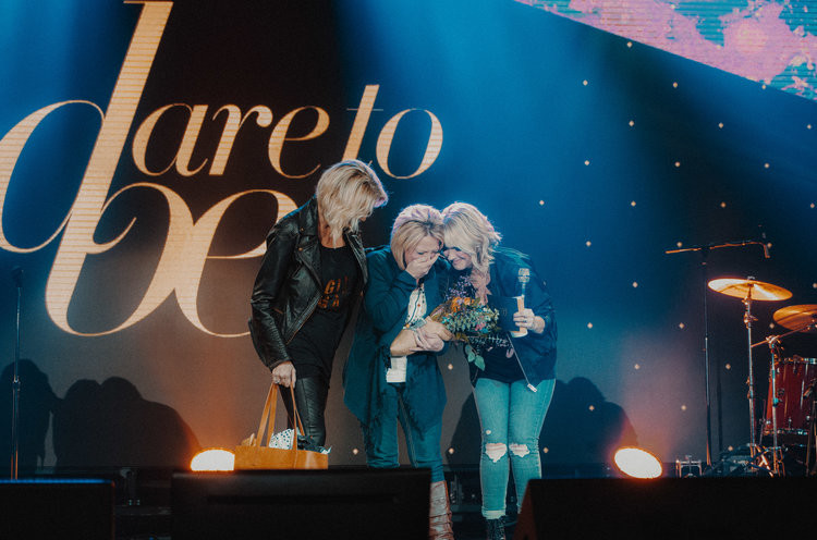 Michele Donnelly receiving the 2018 Baltimore Honoree Award from Natalie Grant, Charlotte Gambill, and the Dare To Be Foundation