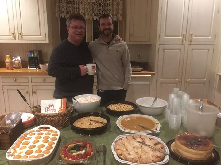 pastor walter donnelly and jesse bane at thanksgiving dinner with desserts