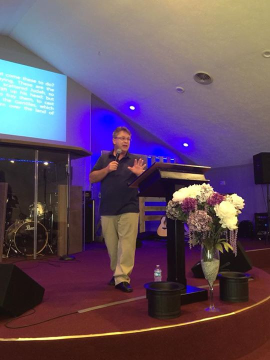 Pastor Walter Donnelly preaching at Strong Tower Church