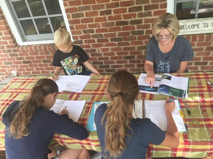 homeschool mom teaching class on the front porch