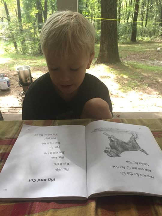homeschool kid reading character booklets
