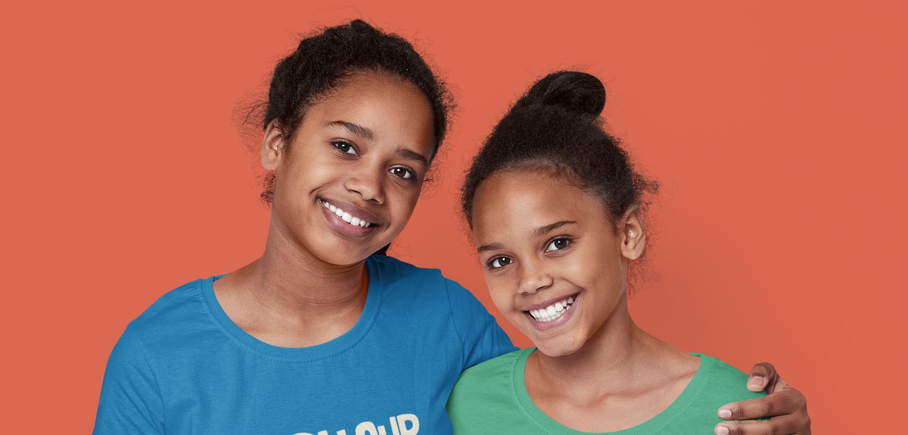 t-shirt-mockup-of-two-sisters-hugging-in-a-studio-46099-r-el2.png