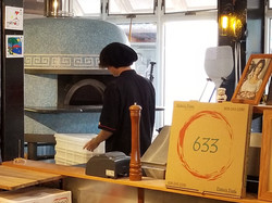 Cooking Pizza in the Brick Oven