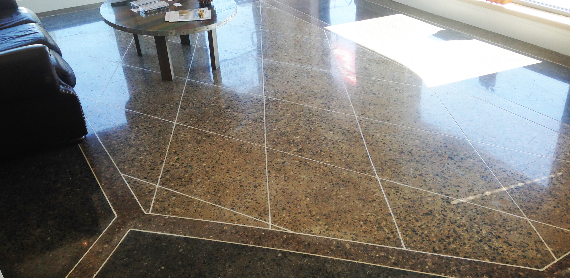Class D Aggregate Exposure with Stain and Decorative Saw Cuts
