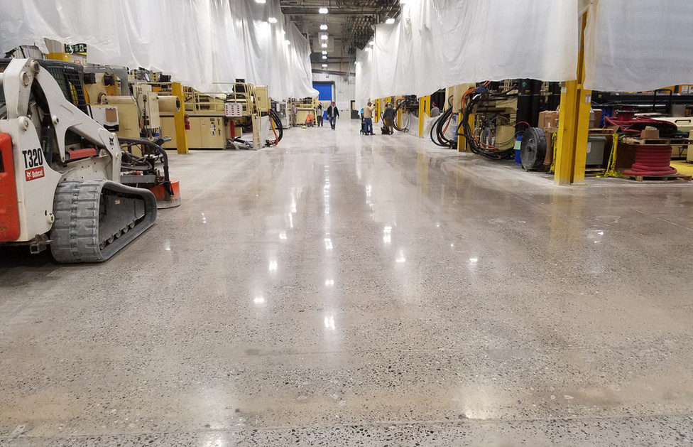 Plastics Recycling Facility, Polishing with Skid Steer