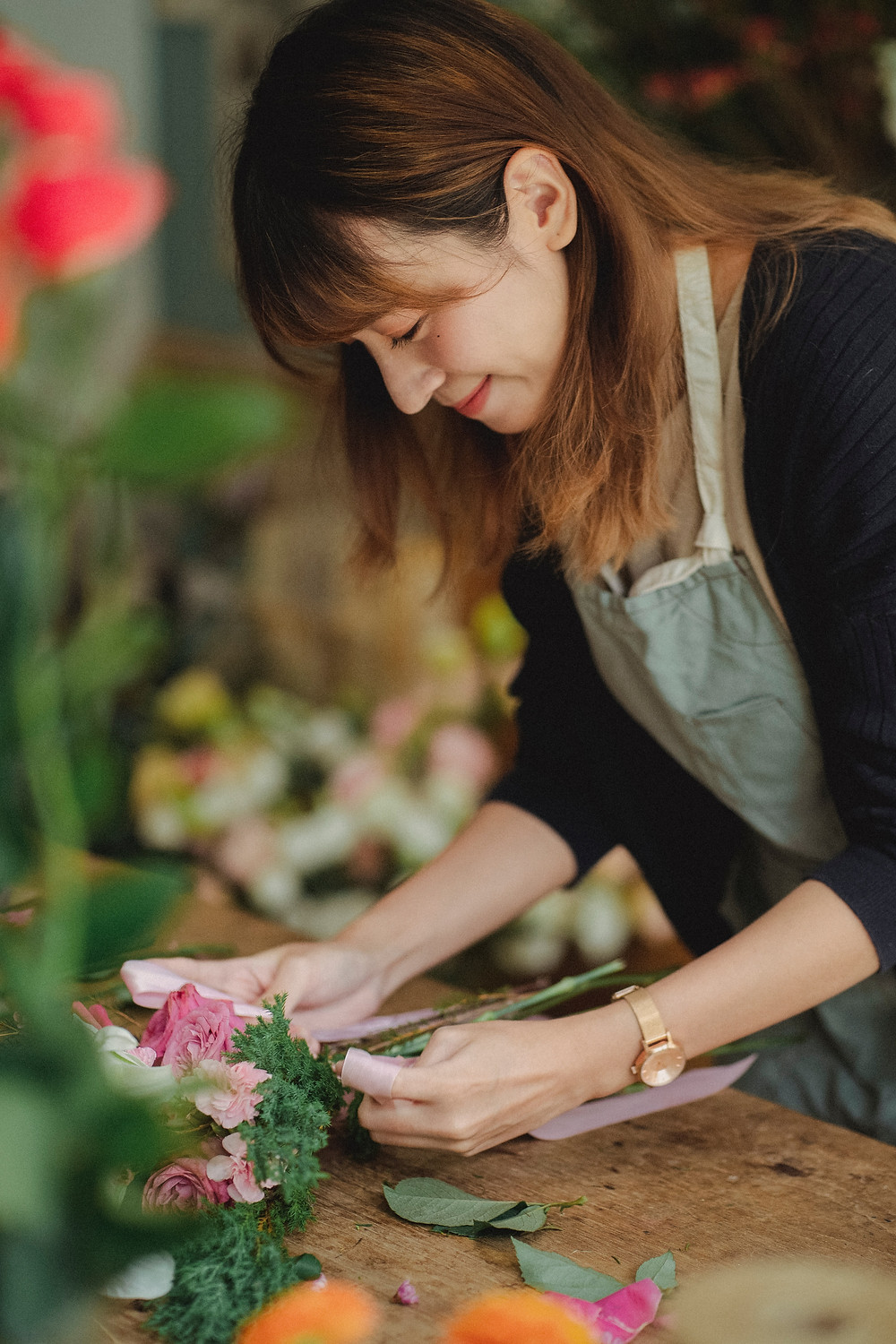 woman florist arranging flowers Evie Studios