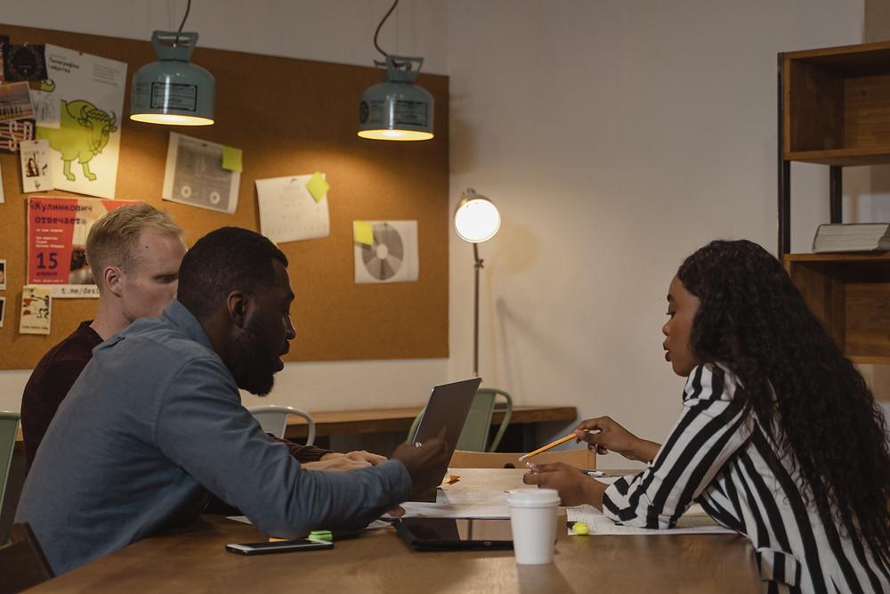Business team working on laptops Evie Studios