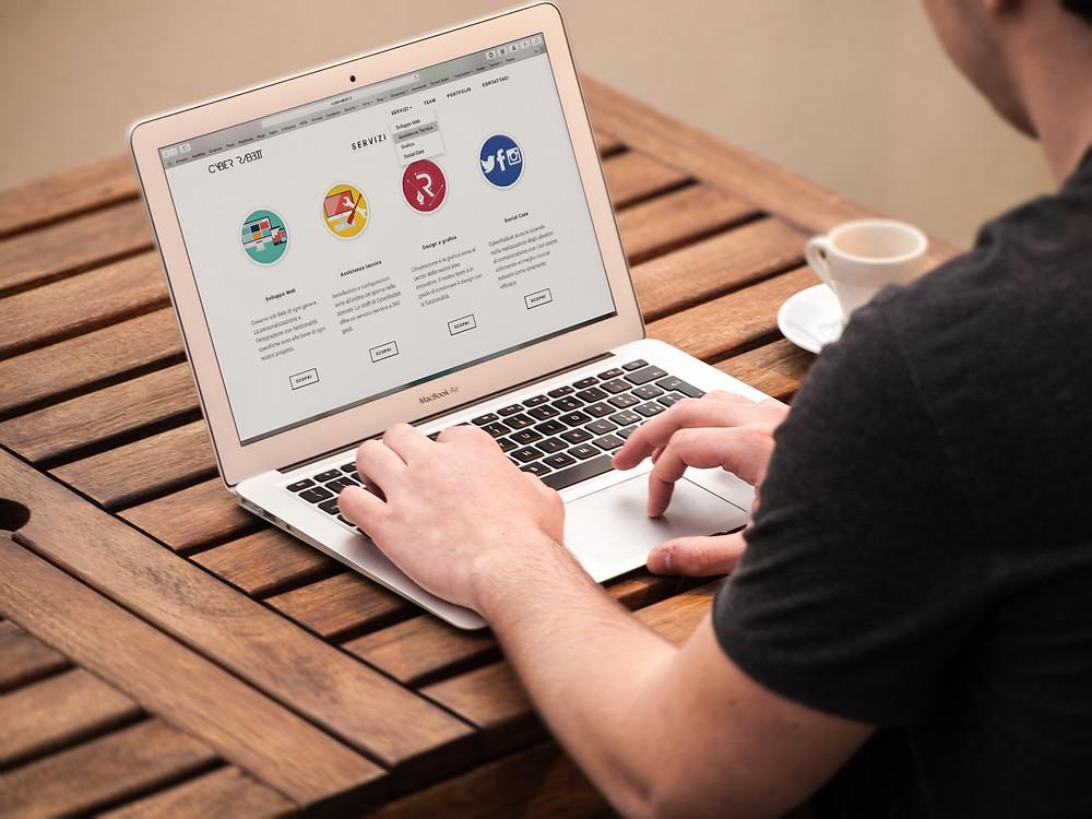 man working on landing page laptop Evie Studios