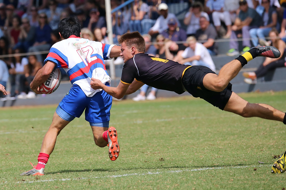 evie studios rugby players tackling each other
