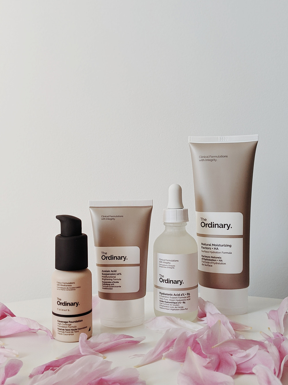 Evie Studios the ordinary skin care product shot sitting with flower petals