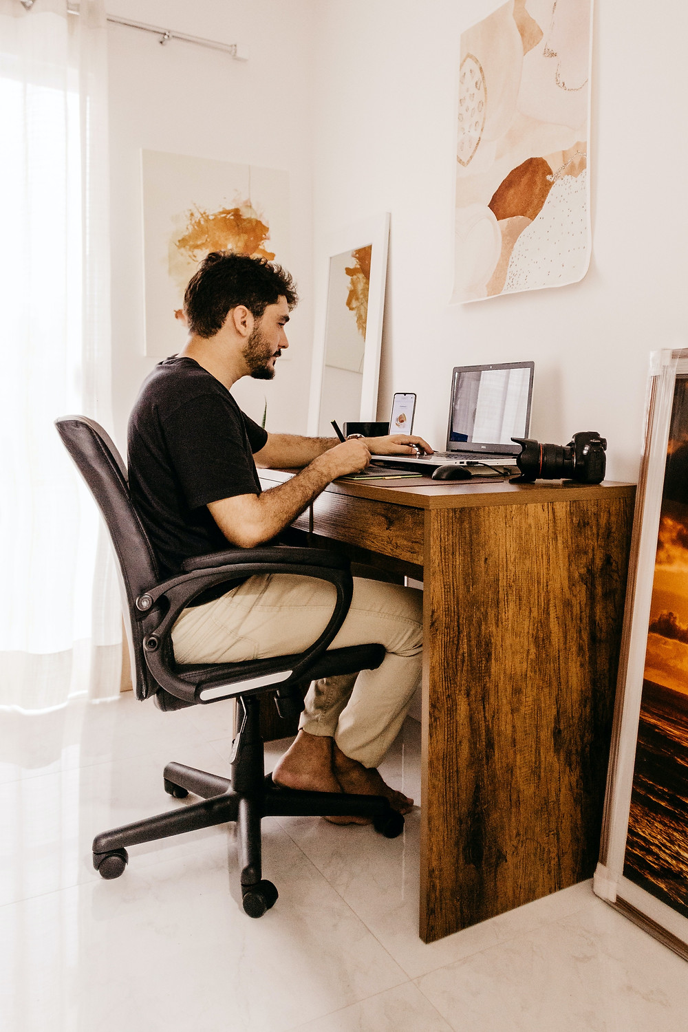 man sitting at desk and working at home Evie Studios