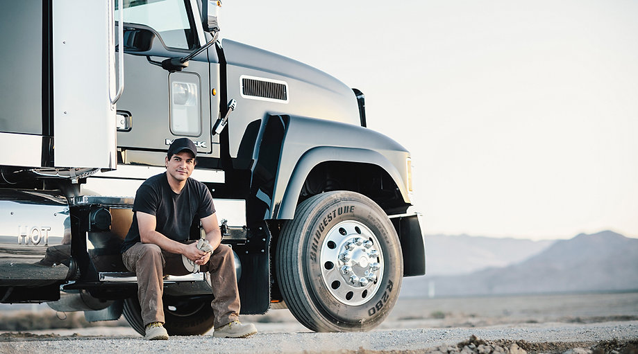 Man sitting in front of truck