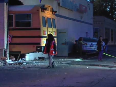 Indiana school bus carrying students crashes into shop