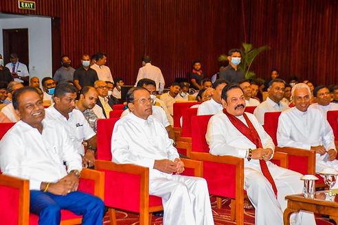 Thilanga Sumathipala sits smiling with M. Sirisena, M. Rajapaksa and P. Jayawardene