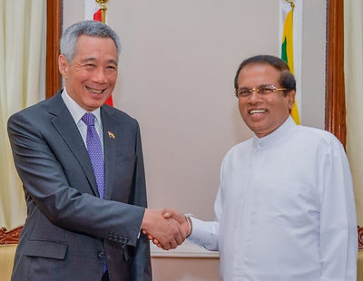 Singapore Prime Minister Lee Hsien Loong shakes hands with former President Maithripala Sirisena during SG-SL FTA