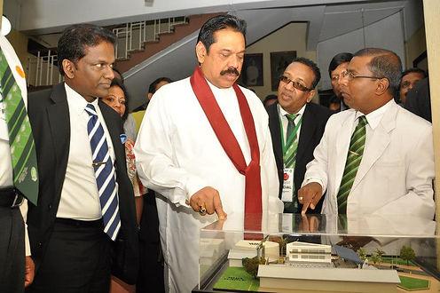 Thilanga Sumathipala inspects a project model with Mahinda Rajapaksa