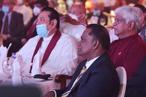 Mahinda Rajapaksa seated with Thilanga Sumathipala and Arjuna Ranatunga at cricket event